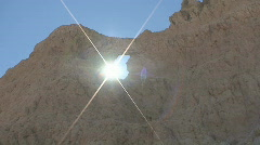 P00589 Sun Flare Through Hole in Badlands Wall Stock Footage