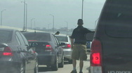 Man Waits Outside Car In Traffic Jam Stock Footage