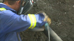 Construction, gas pipe wire brushing Stock Footage