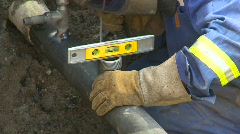 Construction, gas pipe welding with level Stock Footage