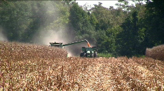 Combine filling a side truck - stock footage