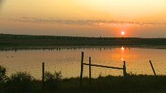 Late summer sunrise over prairie pond Stock Footage