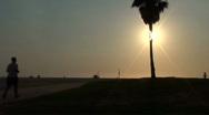 Jogger on beach boardwalk - HD Stock Footage