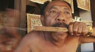 Stock Video Footage of Bali 43 Tengagan Music Mouth Harpe