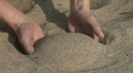 Sand runs through hand - HD Stock Footage