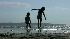 Little Girls Doing Ballet In The Surf Stock Footage