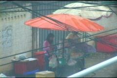 Sidewalk Vendor Selling In The Pouring Rain In Bangkok Stock Footage