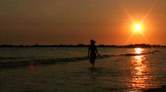 Woman runs into sea - HD Stock Footage