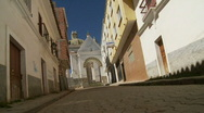 Old man walks down alley in Bolivia Stock Footage