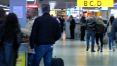 people line up for check in and pan to customs - stock footage