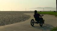 Tricycle on beach boardwalk - HD Stock Footage