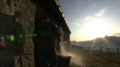 Farmer Cleaning Shed Sunrise Stock Footage