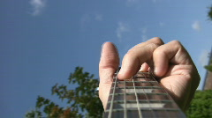 Playing guitar chords. POV. Stock Footage
