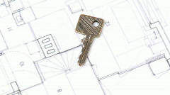 Close-up of a house plan and a key turning Stock Footage