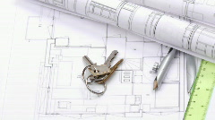 Close-up of plans and keys turning Stock Footage