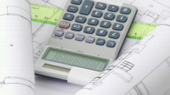 High view of plans and calculator turning - stock footage