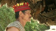 Ifugao tying on his knife 1 Stock Footage