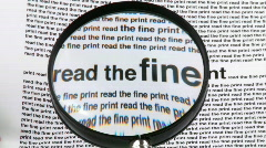 "Magnifying glass showing ""Read the fine print"" words Stock Footage"