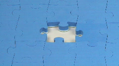 Hand placing the last piece on a puzzle Stock Footage