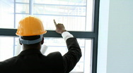 Afro-American architect studying a building through a window Stock Footage