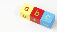 Stock Video Footage of Colorful alphabet toy blocks spelling ABC turning