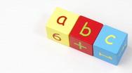 Colorful alphabet toy blocks spelling ABC turning Stock Footage