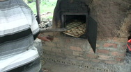 Brick stove baking bread Stock Footage