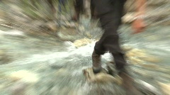 Sports and fitness, hikers crossing creek Stock Footage