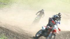 motocross bikes on dusty corner  - stock footage