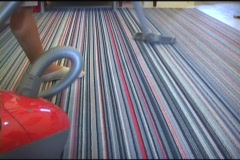 Asian Woman Vacuums Her Living Room Stock Footage