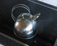 Kettle on a cooker Stock Footage