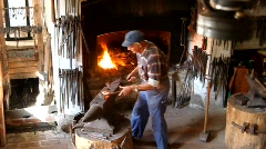Blacksmith forging a horseshoe - stock footage