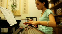 A woman plays traditional Chinese musical instrument Stock Footage