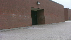 Pan of rear entrance at school Stock Footage