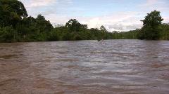 Passenger canoe on the rio Arajuno, Ecuador Stock Footage