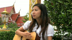 Asian Girl Sings And Plays Worship Songs - stock footage