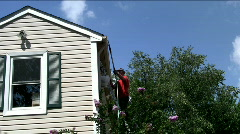 Man cleaning gutters Stock Footage