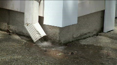 Water out of rain spout Stock Footage