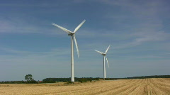Two wind turbines on a field Stock Footage