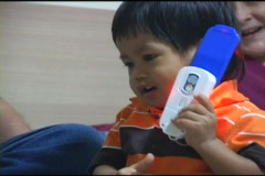 Cute Asian Boy Playing With Toy Cell Phone Stock Footage