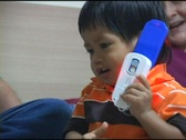 Stock Video Footage of Cute Asian Boy Playing With Toy Cell Phone