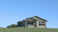 Stock Video Footage of old farmhouse viewed front on