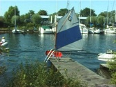 Small sailing boat at a jetty Stock Footage