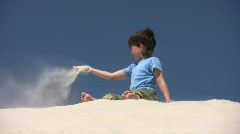 Boy threw sand on wind Stock Footage