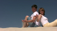 Stock Video Footage of Couple plays with sand