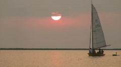 Sailboat At Sunset - stock footage