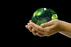 Green Spinning Earth in Hands w/alpha channel Stock Footage