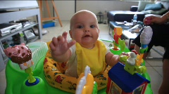 Baby in a bouncy chair, spit up Stock Footage