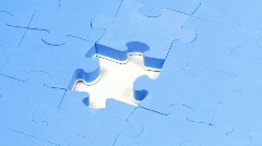 Jigsaw puzzle without the solution piece turning Stock Footage