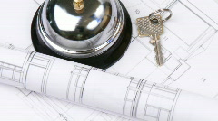 High view of blueprints, key and service bell turning - stock footage